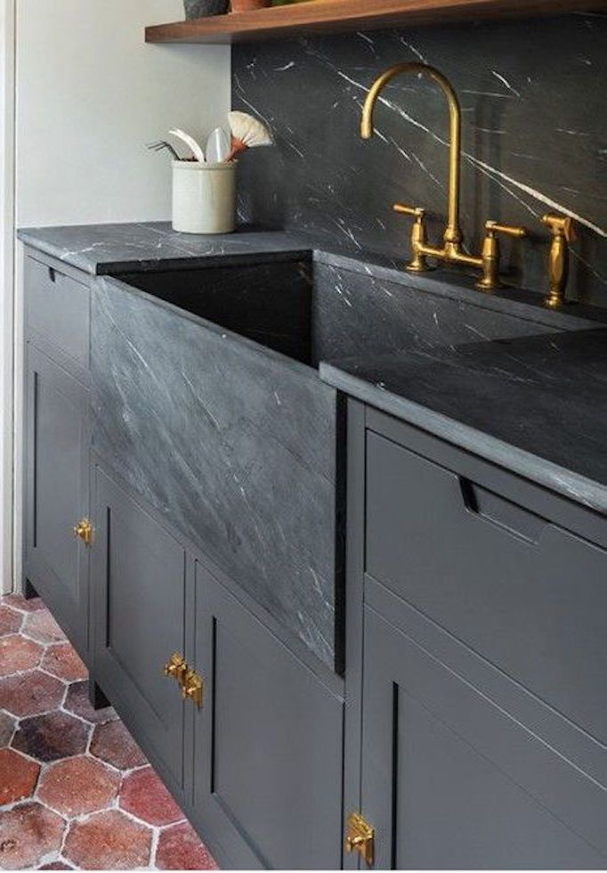 If you are updating your kitchen, you could go with classic white, or consider these white apron sink alternatives in black, brass, copper, and stainless